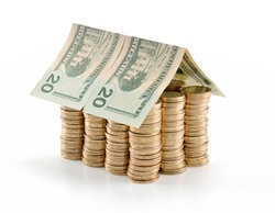 Invest in real estate concept. Twenty US dollar bill roof on coins isolated on white background.