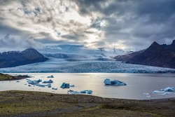 View of the lake and vatnajokull glacier in evening in Iceland