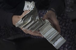 Man holding lots of money