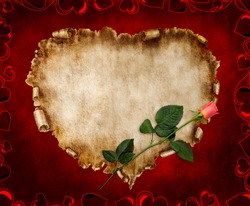 Heart-shaped vintage piece of parchment with a red rose on it. Valentines Day Card romantic love letter on red background.