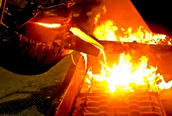 metal casting process with high temperature fire in metal part factory