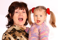 Portrait of grandmother and granddaughter. White background.
