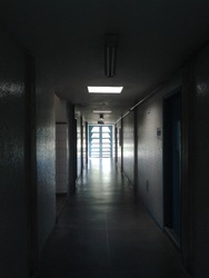 Dark corridor with light coming from the end