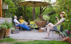 People relaxing in a garden