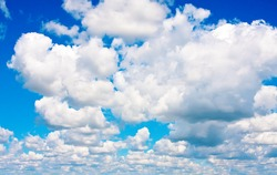 Background of blue sky with cumulus clouds in fine summer day
