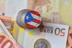 euro coin with national flag of puerto rico on the euro money banknotes background. finance concept