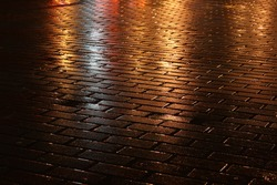 night wet pavement shining golden lights