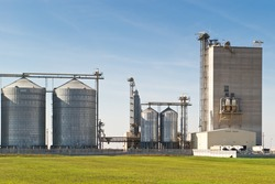 grain silos for agriculture on blue sky