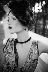 Retro Woman Portrait. Beautiful Woman. Vintage Styled Photo. Old Fashioned Makeup and Finger Wave Hairstyle. 20th or 30th style