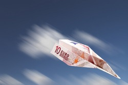 Paper plane made with a ten euro banknote falling.