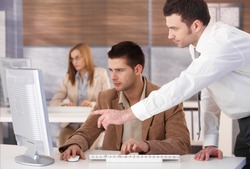 Young businesspeople participating at computer course.?