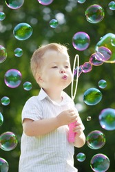 The image of the child blow bubbles