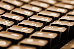 Close-up of computer keyboard. Toned in sepia