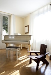 Interior house, nice livingroom piano and chair