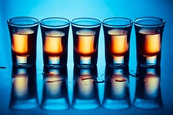 five hot drink shots with reflection in bar