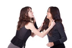 Two attractive young women grabbing each other's hair and appearing to be angry