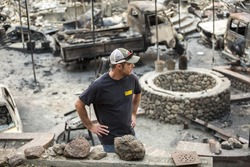 GLEN ELLEN, CALIFORNIA/ USA - OCT 16, 2017: A man stands in the ruins of his burned home in Glen Ellen. Fires in California have burned over 220,000 acres and destroyed 5700 structures.