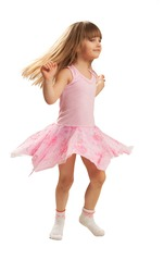 Adorable five year old girl dancing around on white background