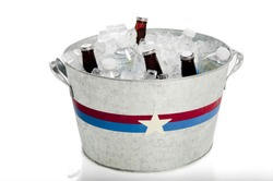 Patriotically painted metal tub with beer and water bottles
