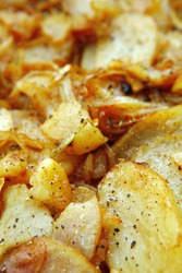 image of golden fried potatoes as background . shallow dof