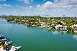Aerial view of the Indian Creek Canal in Miami Beach with Downtown Miami skyline in the back.