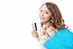 A beautiful young girl with bags and credit card is isolated