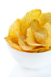 Pile of potato chips in a white bowl.