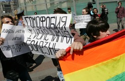 "MOSCOW - MAY 28: Gay rights activists take part in the unauthorized gay pride parade in central Moscow, Russia on May 28, 2011. The banner in centre reads ""Homophobia can be cured""."