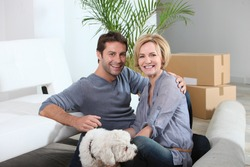 Couple and dog move in to new home