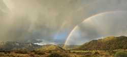 A rare double rainbow appears over Albuquerque's Sandia Mountains in the monsoon season