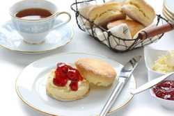 scone with strawberry jam and clotted cream , cream tea , devonshire tea , tea party , afternoon tea , buttermilk biscuits