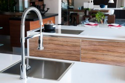 Shiny stainless steel faucet with chrome water tap
