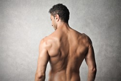 Rear view of a handsome bare-chested man