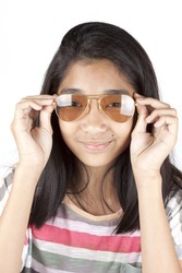 teenager, Asian girl wearing light brown sunglasses.