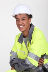 Young worker in a fluorescent jacket