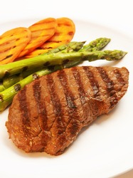 Grilled steak with green asparagus and carrot