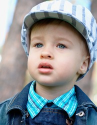 Close-up portrait of a serious baby outdoors