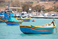 Marsaxlokk village and traditional colorful boats in Malta