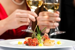 Couple for romantic Dinner or lunch in a gourmet restaurant