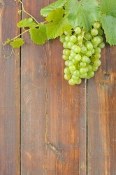 White grapes on a wooden table.