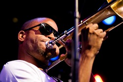 SEATTLE - SEPT 3:  Troy Andrews of Trombone Shorty & Orleans Avenue performs on stage during the Bumbershoot Music festival in Seattle, Washington on September 3, 2011.