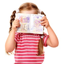 Little girl  holding international passport. Foreign vacation.