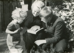 Vintage photo of mother reading with children (fifties)