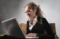 Smiling businesswoman using a laptop
