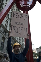 NEW YORK - OCTOBER 05: Kevin Gunderson of New York holds sign at the rally with 'Occupy Wall Street' in Downtown Manhattan on October 05, 2011 in New York.