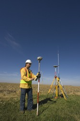 Land surveyor working with GPS unit