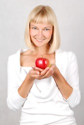 Nutritional value/ Beautiful Young Woman holding an apple