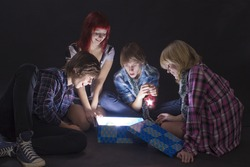 Portrait of  teenagers looking in a magic lighting box