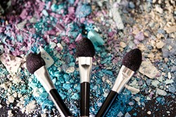 colourful eyeshadow powders and make-up brushes