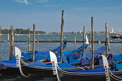 Numerous parked gondolas on the canal near the famous Piazza San Marco, Venice, Italy. Venice - UNESCO world heritage